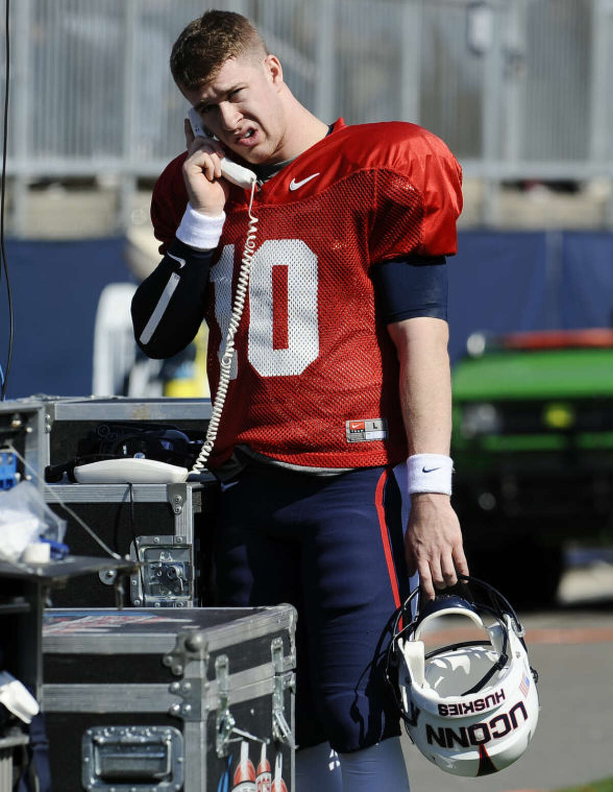 Connecticut quarterback Chandler Whitmer talks on the phone during the first half of UConn's Blue-White spring NCAA college football game at Rentschler Field, Saturday, April 12, 2014, in East Hartford, Conn. (AP Photo/Jessica Hill)