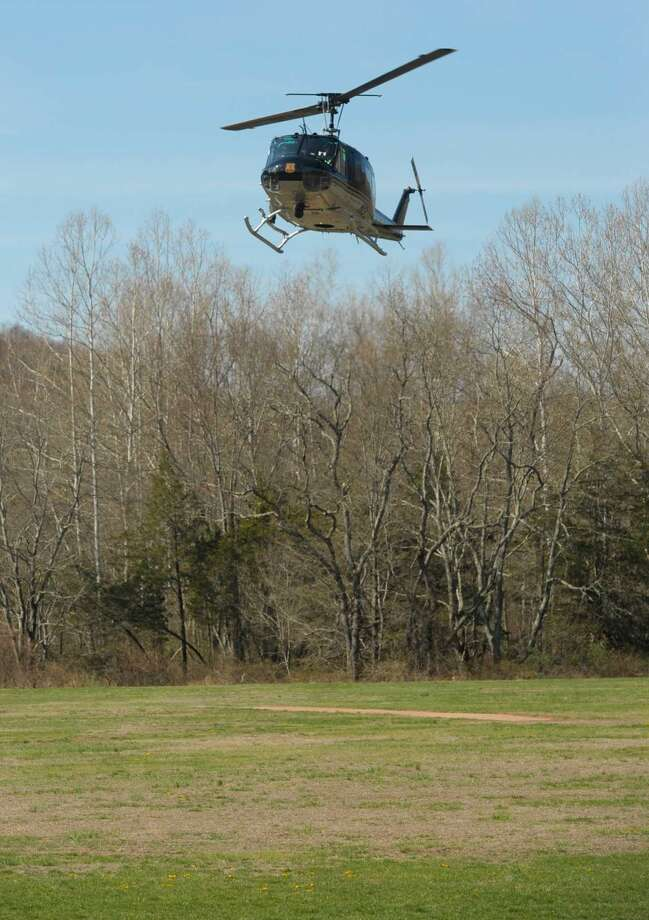 Eagle 1 search and rescue helicopter lands in Clatter Valley Park, in New Milford, on Saturday morning. It was taking part in a search and rescue drill along with fire departments, police, EMS, K-9, and others on Saturday, April 16, 2016, in New Milford, Conn.