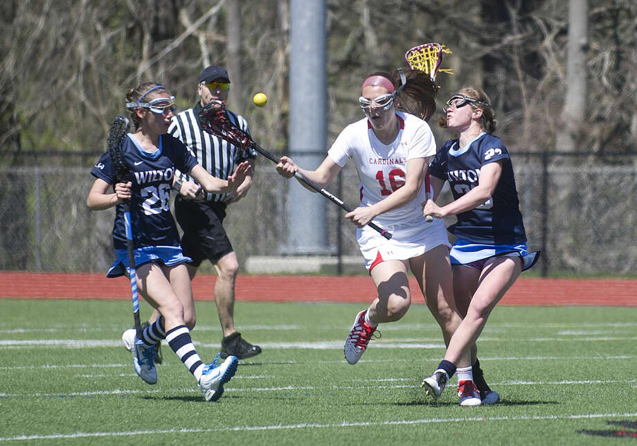 Greenwich's Sloane Caan controls the ball during Saturday's girls lacrosse game against Wilton at Greenwich High School on April 16, 2016.