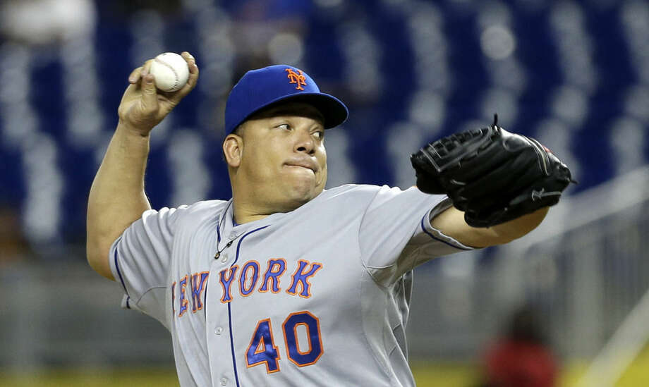New York Mets' Bartolo Colon (40) pitches against the Miami Marlinsin the first inning of a baseball game, Wednesday, April 29, 2015, in Miami. (AP Photo/Alan Diaz)