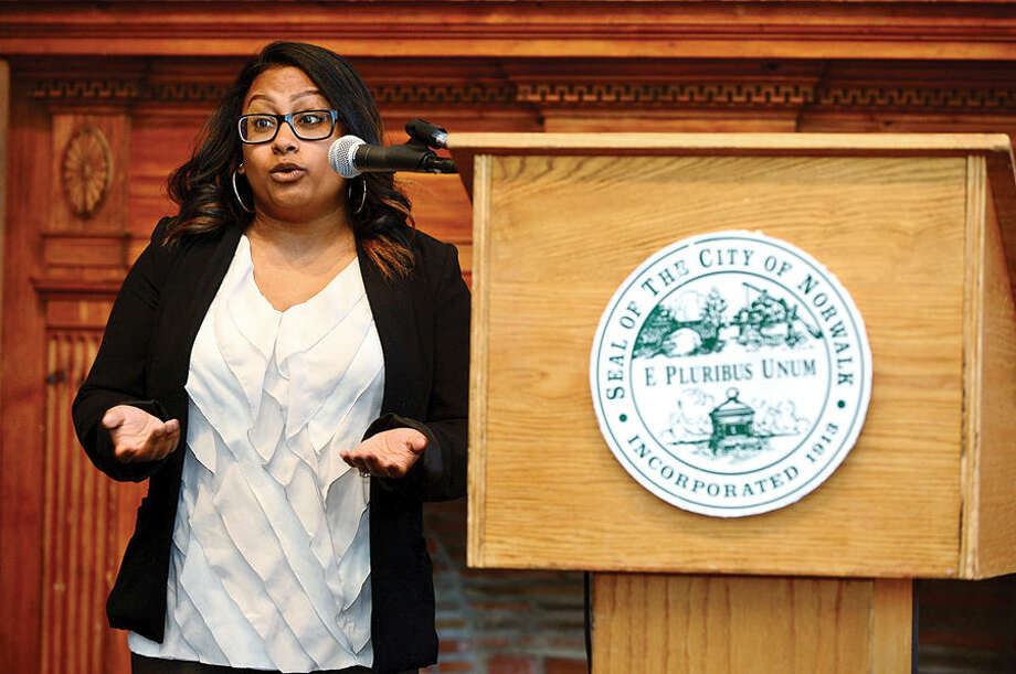 Hour photo / Erik Trautmann Former program participant Diane Matheus speaks of her experience during the 2nd annual Mayor's Summer Youth Employment Breakfast Wednesday at City Hall where businesses learned of the benefits of interning Norwalk High School students.