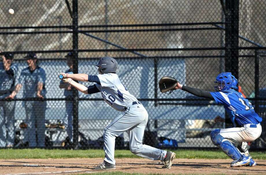 Immaculate's Wesley Scriven (10) pops up a bunt back to the pitcher in the boys baseball game between Immaculate and Abbott Tech high schools, on Friday afternoon, April 15, 2016, at Abbott Tech High School, Danbury, Conn. Dan Collinge (18) is catching for Abbott Tech.