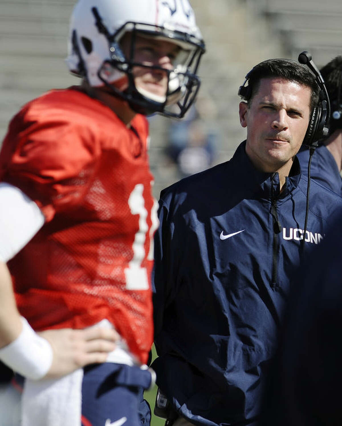 Connecticut coach Bob Diaco, right, looks toward quarterback Tim Boyle, left, during the first half of UConn's Blue-White spring NCAA college football game at Rentschler Field, Saturday, April 12, 2014, in East Hartford, Conn. (AP Photo/Jessica Hill)