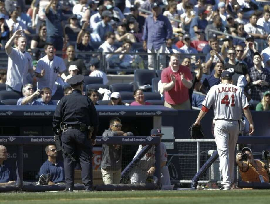 Boston Red Sox's John Lackey (41) leaves he game during the sixth inning of a baseball game against the New York Yankees Saturday, April 12, 2014, in New York. (AP Photo/Frank Franklin II)