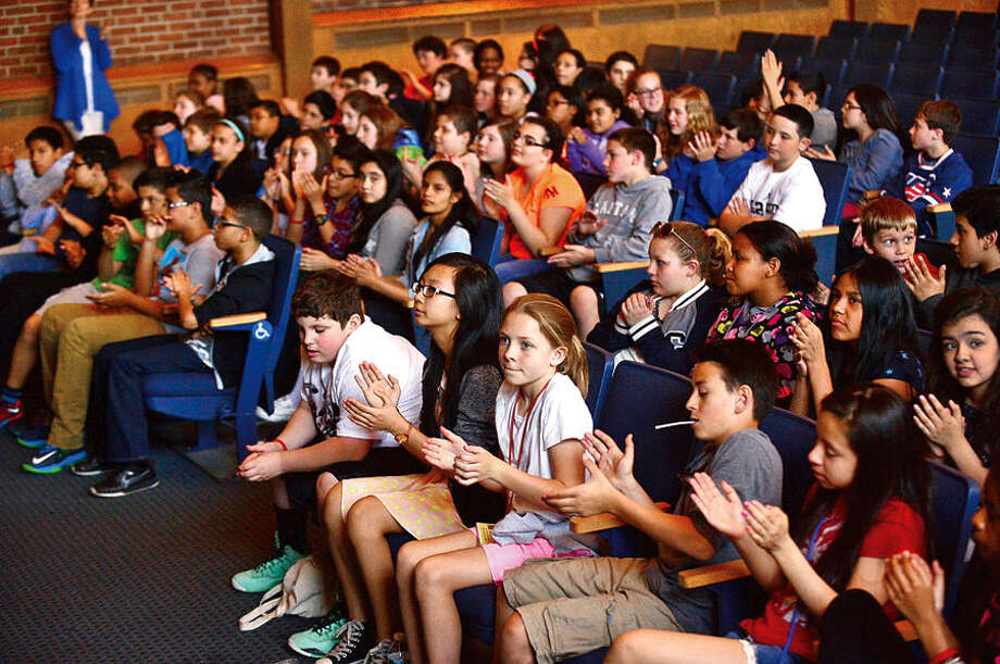 Hour photo / Erik Trautmann Nathan Hale Middle School 6th graders listen to a anti-bullying presentation by students in Norwalk High School Peace Works program Thursday.