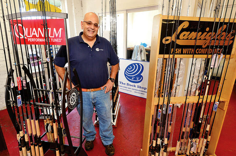 Hour photo / Erik Trautmann The Dock Shop P. Sales and Marketing, Michael La Scala, in their new store at 609 Riverside Ave. in Westport.