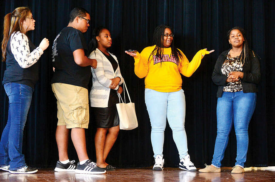 Hour photo / Erik Trautmann Students in Norwalk High School Peace Works program, Brenda Gutierrez, Daniel Smith, Barbara Nelson, Assata Toney and Stephanie Pierre perform a skit on anti-bullying for 6th graders at Nathan Hale Middle School Thursday.