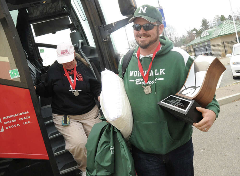 Chris Rivera band leader of the Norwalk High School Winter Percussion ensemble gets off the bus Sunday. The Band won a Silver Medal in the WGI World They came in Second behind a group from Mississippi and just ahead of a group from Virginia. Hour photo/Matthew Vinci