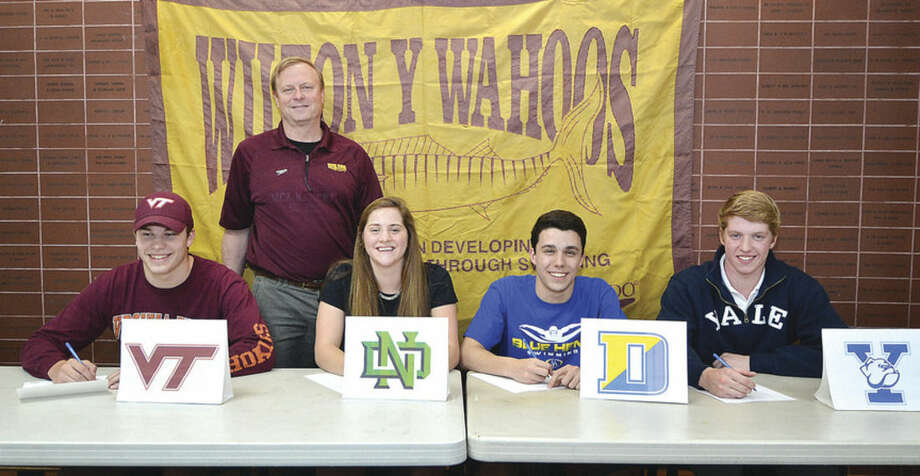 Next-level performersWilton Y Wahoos' head coach Randy Erlenbach stands behind his swimming signees from the left, Stamford's Oscar Ike who is going to Virginia Tech, Wilton's Syndi Robinson, who if going to the University of Notre Dame, Norwalk's Dillon DiGugliemo who is going to the University of Deleware and Weston's Edward Stolarski is going to Yale University. To read a complete story on all four swimmers, visit us online at www.wiltonvillager.com.Hour photo/Alex von Kleydorff