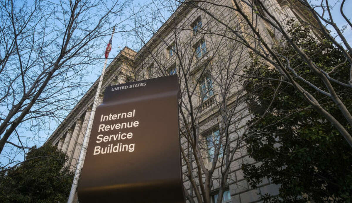 This April 13, 2014 photo shows The Internal Revenue Service Headquarters (IRS) building Washington. The Internal Revenue Service already has received nearly 100 million tax returns, but anticipates getting about 35 million more by the midnight Tuesday deadline. Many other taxpayers, however, are opting for plan B and asking for more time to file. (AP Photo/J. David Ake)