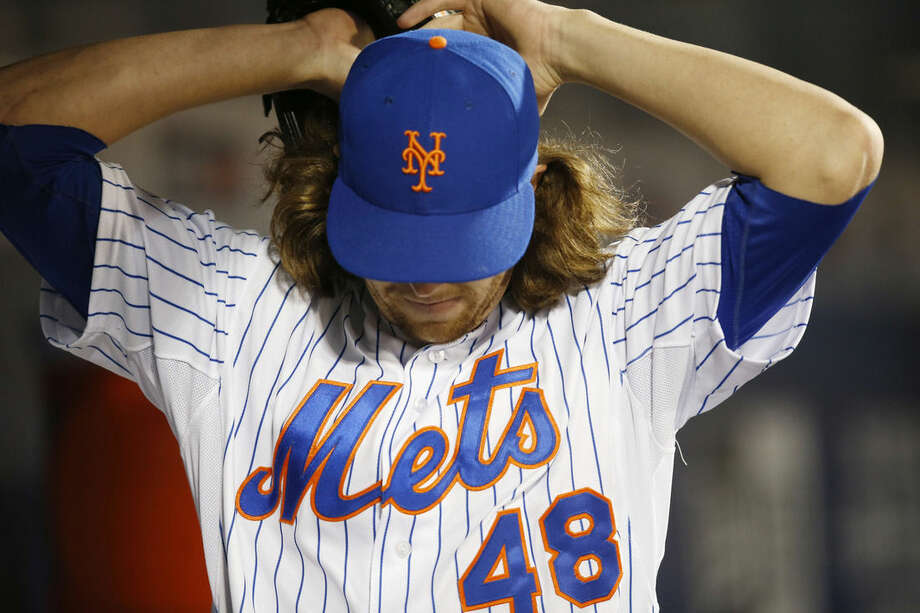 New York Mets starting pitcher Jacob deGrom (48) reacts after New York Mets manager Terry Collins removed him from the game in sixth inning of a baseball game in New York, Thursday, April 30, 2015. deGrom allowed five runs in five and a third innings. (AP Photo/Kathy Willens)