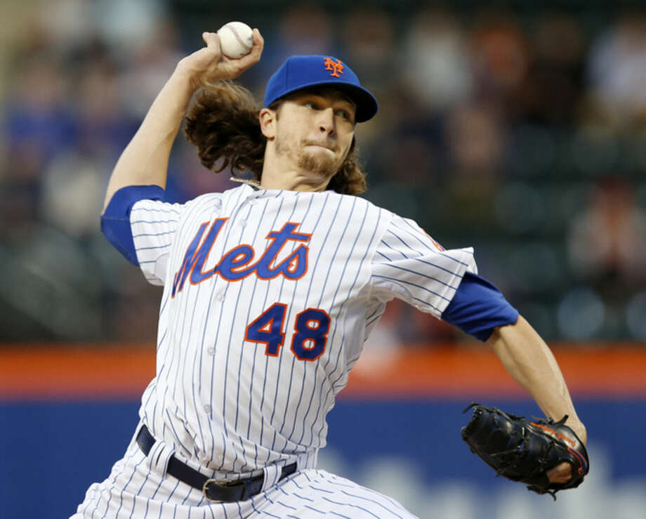 New York Mets starting pitcher Jacob deGrom delivers in the first inning of a baseball game against the Washington Nationals in New York, Thursday, April 30, 2015. (AP Photo/Kathy Willens)