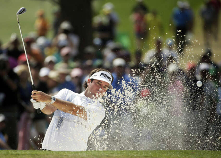 Bubba Watson hits out of a bunker on the seventh hole during the fourth round of the Masters golf tournament Sunday, April 13, 2014, in Augusta, Ga. (AP Photo/Chris Carlson)