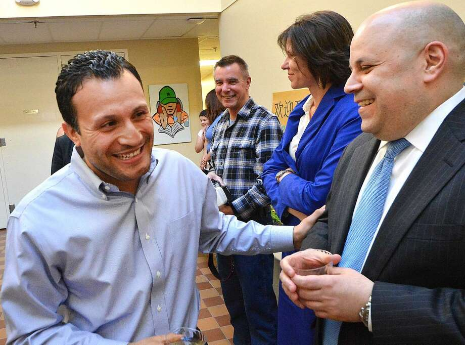 Hour Photo/Alex von Kleydorff Warren Pena and Felix Serrano Chairman of the Redevelopment agency share a smile as the SONO Community Center celebrates a new look