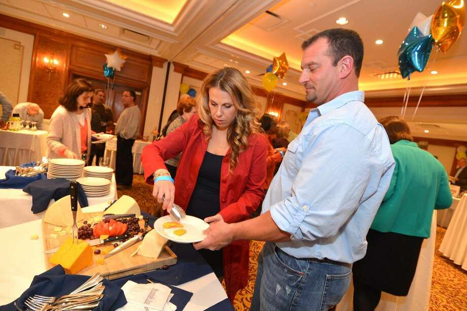 Hour Photo/Alex von Kleydorff. The Norwalk Police Department holds the Sixth Annual Wine Tasting and Auction to benefit the programs of the Police Athletic League