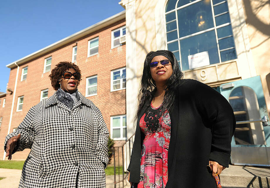 Community advocate and Roodner Court resident Deidra Davis, left, and Norwalk Board of Education member Shirley Mosby in the Roodner Court public housing complex in Norwalk, Conn. on Wednesday, April 13, 2016. There is a proposal to open three new schools in the city to deal with overcrowding, including the former Nathaniel Ely School which is adjacent to the complex.