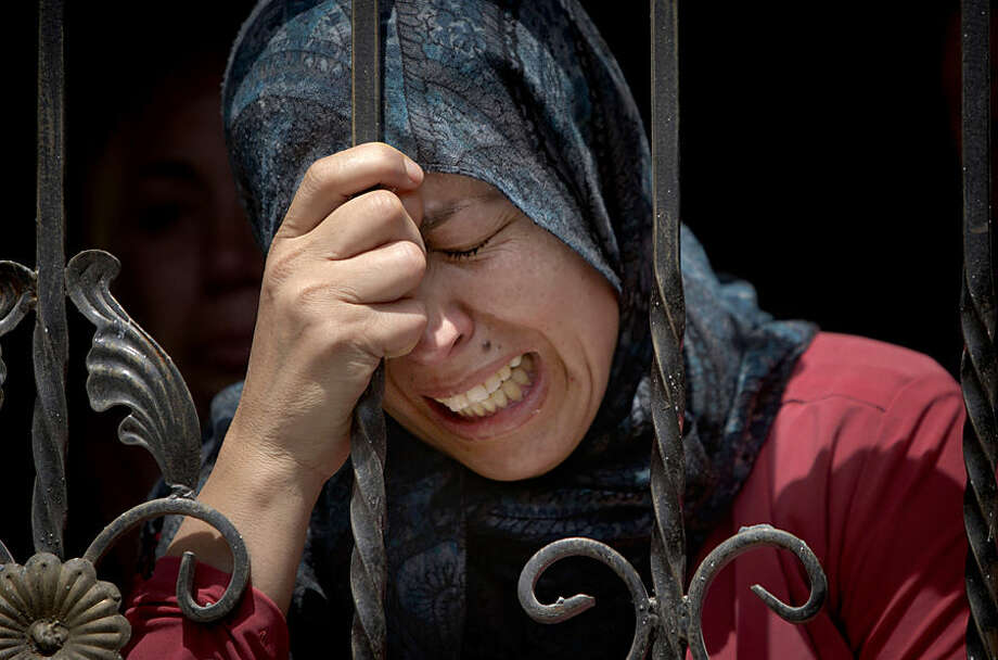 A Palestinian mourns during the funeral of Mohammed Yehya, who died from wounds in clashes with Israeli troops the night before, during his funeral procession, in the al-Araqa village in the west bank city of Jenin, Tuesday, April 28, 2015. The officials say Yehya died on Tuesday at a hospital in the West Bank city of Nablus. Palestinians say he was shot in the abdomen the on Monday night after hurling rocks at Israeli troops. (AP Photo/Majdi Mohammed)