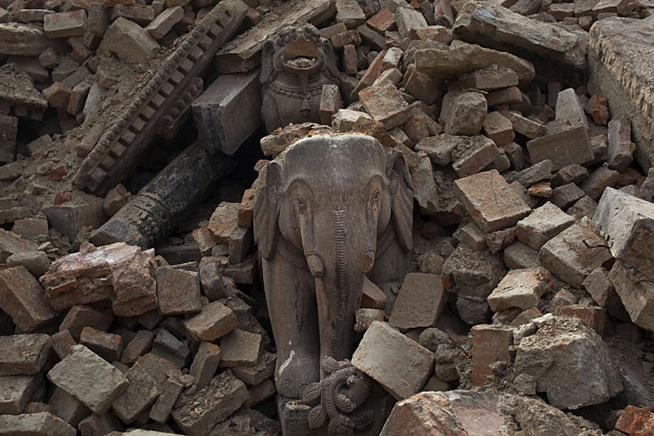 View of the debris of collapsed Bhaktapur Durbar Square after Saturday's earthquake, in Bhaktapur, Nepal, Tuesday, April 28, 2015. Across central Nepal, including in Kathmandu, the capital, hundreds of thousands of people are still living in the open without clean water or sanitation since Saturday's massive earthquake, one of the worst to hit the South Asian nation in more than 80 years. (AP Photo/Bernat Armangue)