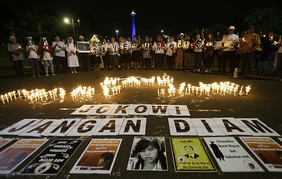 "Indonesian protesters gather with candles and banners that read: ""Save the Mary Jane, Jokowi (President Joko Widodo), Don't be silent"" during a demonstration to demand the government to stop the execution of convicted Filipino Mary Jane Veloso, in Jakarta, Indonesia, Monday, April 27, 2015. Indonesia notified nine foreigners and a local man convicted of drug trafficking that their executions will be carried out within days, ignoring appeals by the U.N. chief and foreign leaders to spare them. (AP Photo/Achmad Ibrahim)"