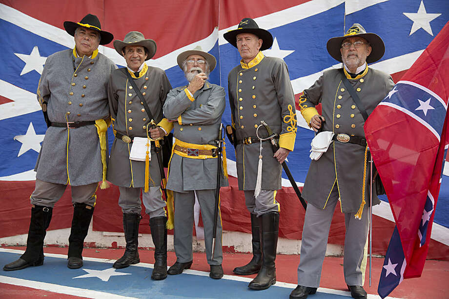 "Descendants of American Southerners wearing Confederate-era uniforms pose for pictures as they attend a party to celebrate the 150th anniversary of the end of the American Civil War in Santa Barbara d'Oeste, Brazil, Sunday, April 26, 2015. For many of the residents of Santa Barbara d'Oeste and neighboring Americana, in Brazil's southeastern Sao Paulo state, having Confederate ancestry is a point of pride and is celebrated in high style at the annual ""Festa dos Confederados,"" or ""Confederates Party"" in Portuguese. (AP Photo/Andre Penner)"