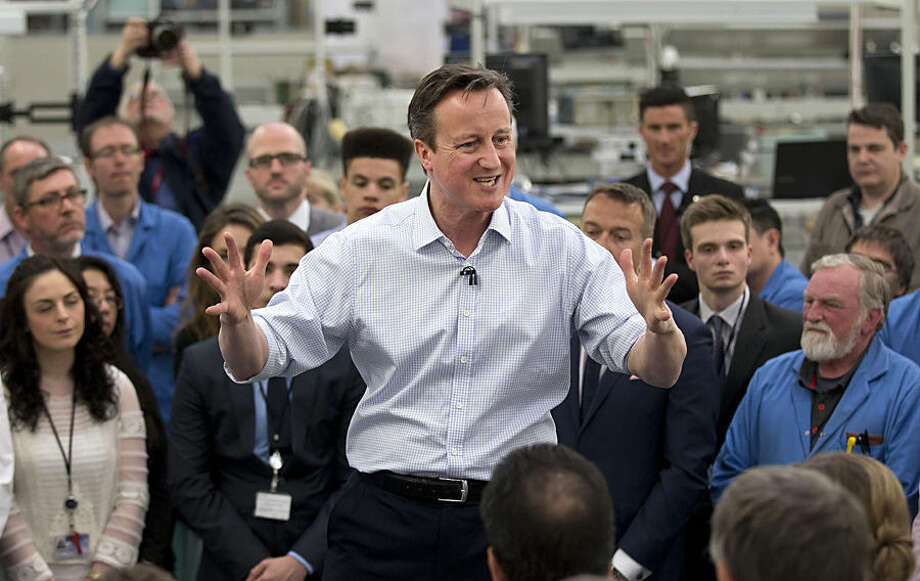 Britain's Prime Minister and leader of the Conservative Party David Cameron makes a speech surrounded by workers during his visit to Kelvin Hughes, a company which manufactures naval tactical radar systems, in north London, Tuesday, April 28, 2015. Britain goes to the polls in a General Election on May 7. (AP Photo/Matt Dunham, Pool)