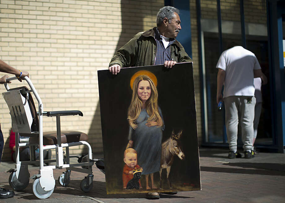 "Artist Kaya Mar poses for photographs with his painting entitled ""Saint Kate"" across the street from the Lindo Wing of St Mary's Hospital in London, Monday, April 27, 2015. Britain's Kate the Duchess of Cambridge is expected to give birth to her second child with her husband Prince William at the hospital in the coming days. Palace officials have said the baby is due in late April. A small number of dedicated royal fans are waiting or camping outside the hospital awaiting the imminent birth. (AP Photo/Matt Dunham)"