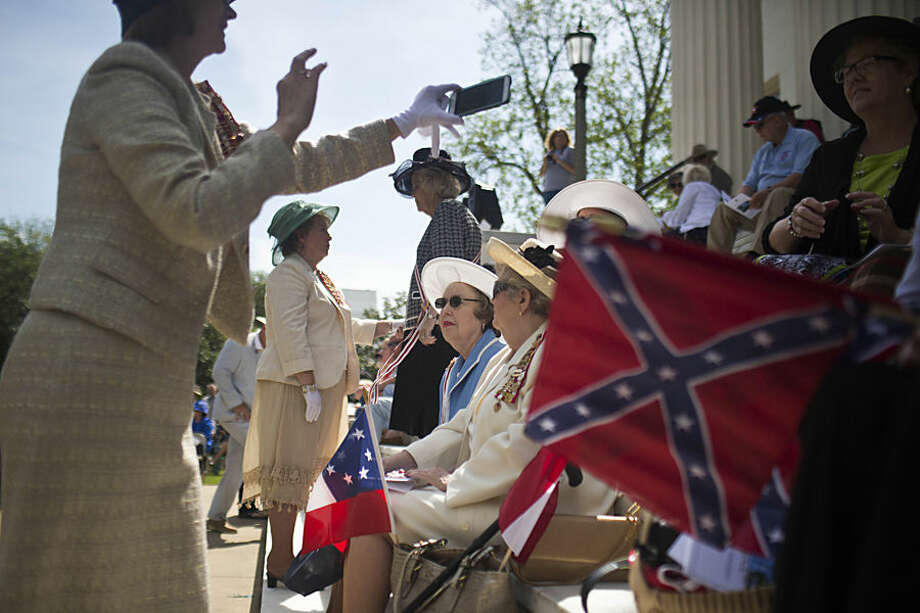 Members of the United Daughters of the Confederacy gather on the steps of the Alabama State Capitol to celebrate Confederate Memorial Day, Monday, April 27, 2015, in Montgomery, Ala. Nearly 100 people met on Monday to mark the official Alabama state holiday. (AP Photo/Brynn Anderson)