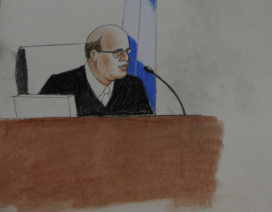In this Monday, April 27, 2015, sketch by courtroom artist Jeff Kandyba, Judge Carlos A. Samour, Jr., makes a point during the opening day of the trial for Aurora, Colo., theatre shooting suspect James Holmes Monday, April 27, 2015, in Centennial, Colo. The trial will determine if Holmes will be executed, spend his life in prison or be committed to an institution as criminally insane. (AP Photo/Jeff Kandyba)