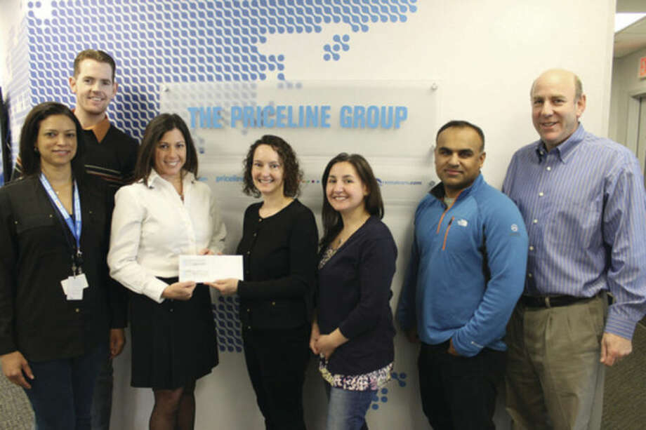 Contributed photoFamily Centers' Director of Community Engagement Jennifer Flatow (second from left) accepts a check from Priceline.com employees (left to right) Angela Jamerson, Ben Harrell, Jill Saverine, Eleana McNeill, Baiju Thakkar and Ken Weil.