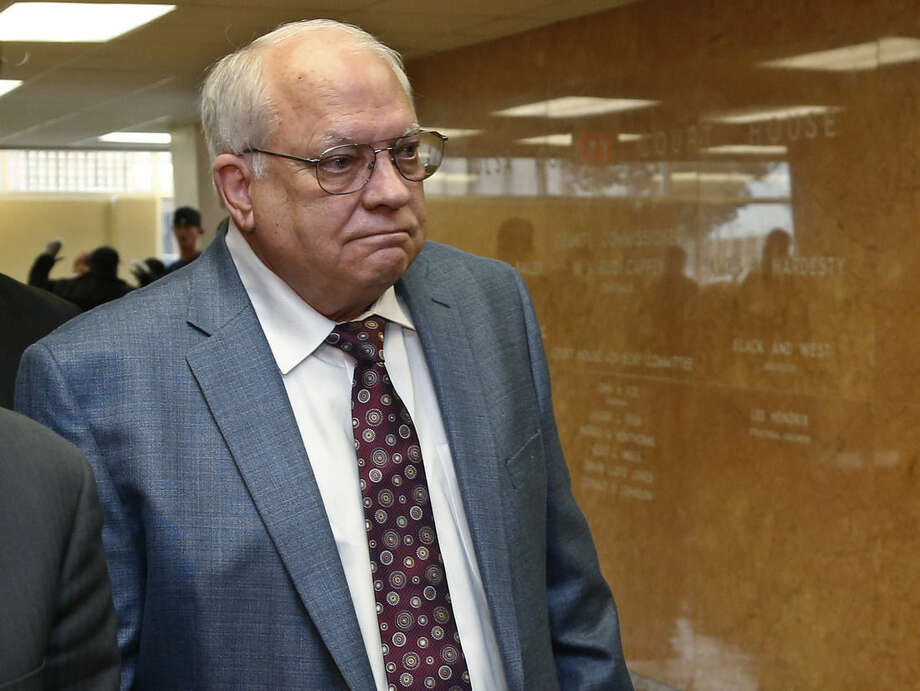 FILE - In this Tuesday, April 21, 2015 file photo, Robert Bates arrives for his arraignment at the Tulsa County courthouse in Tulsa, Okla. Bates, a 73-year-old Tulsa County reserve deputy who fatally shot a suspect who was pinned down by officers, is facing a second-degree manslaughter charge. (AP Photo/Sue Ogrocki)