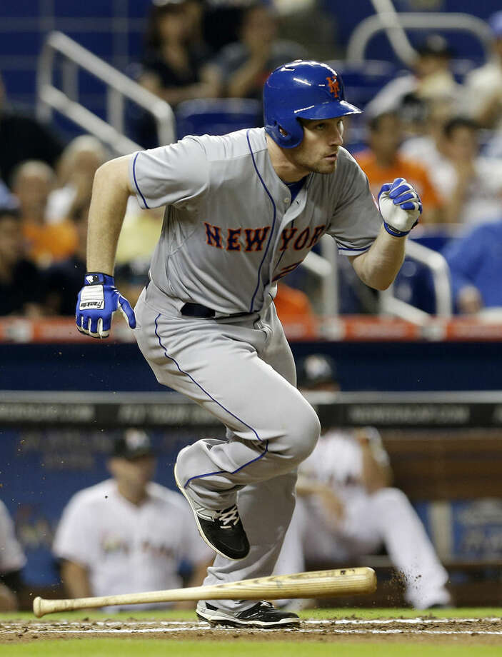 New York Mets' Daniel Murphy heads to first base after batting a single against the Miami Marlins in the fourth inning of a baseball game, Tuesday, April 28, 2015, in Miami. (AP Photo/Alan Diaz)