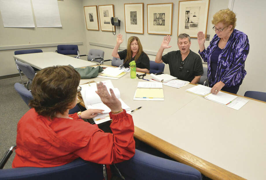 Moderators are sworn in during a training session by Registrar of Voters Karen Doyle Lyons at Norwalk City Hall on Monday April 25 2016