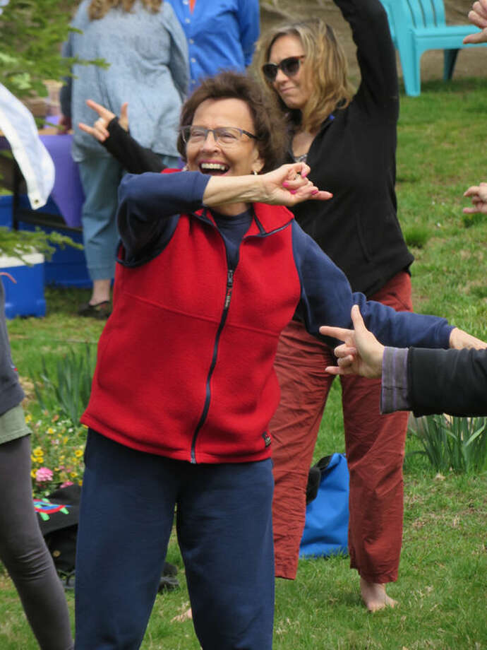 """Qigong (Chinese meditative movement which directs the """"qi"""" or """"chi""""—our """"life force"""" energy so it can flow through the body for good health) on the lawn with Norwalkers Qigong Master Bill Wrenn and Qigong instructor Helen Rasmussen (a St. Paul's parishioner)."""