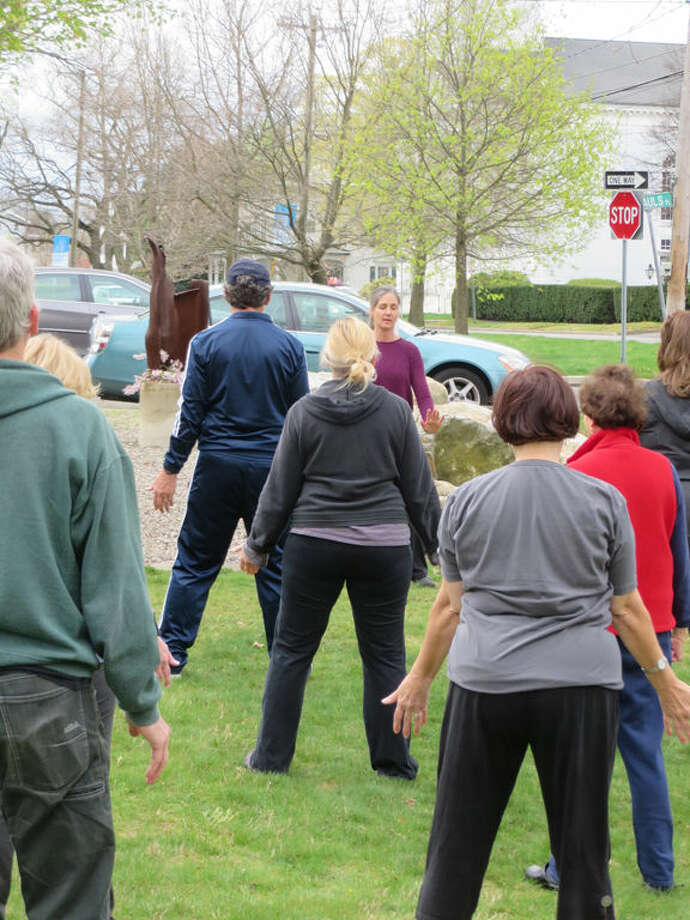 "Qigong (Chinese meditative movement which directs the ""qi"" or ""chi""—our ""life force"" energy so it can flow through the body for good health) on the lawn with Norwalkers Qigong Master Bill Wrenn and Qigong instructor Helen Rasmussen (a St. Paul's parishioner)."