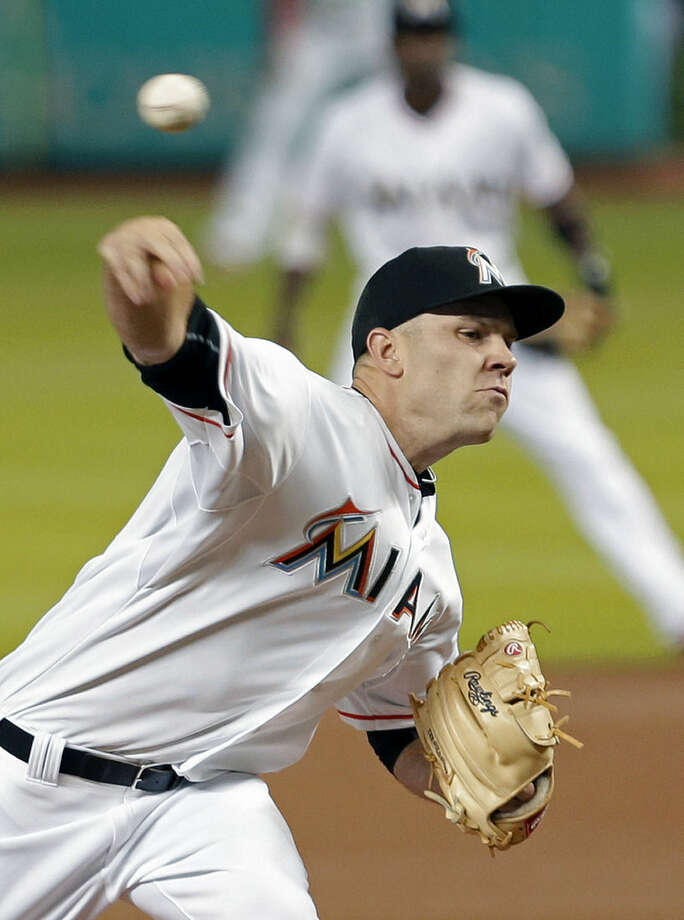 Miami Marlins' David Phelps pitches against the New York Mets in the first inning of a baseball game, Tuesday, April 28, 2015, in Miami. (AP Photo/Alan Diaz)