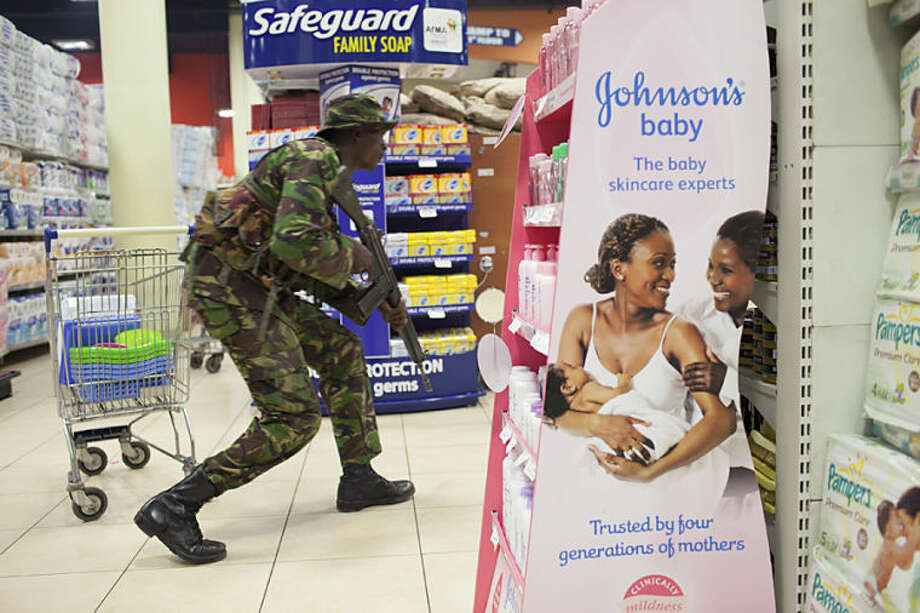 In this Sept. 21, 2013 photo provided by the New York Times, part of New York Times photographer Tyler Hicks' Pulitzer Prize-winning portfolio, a soldier searches for armed militants who entered the Westgate Mall in Nairobi, Kenya, attacking people at the upscale shopping mall. Hicks was awarded the 2014 Pulitzer Prize for breaking news photography, it was announced Monday, April 14, 2014, in New York. (AP Photo/The New York Times, Tyler Hicks)