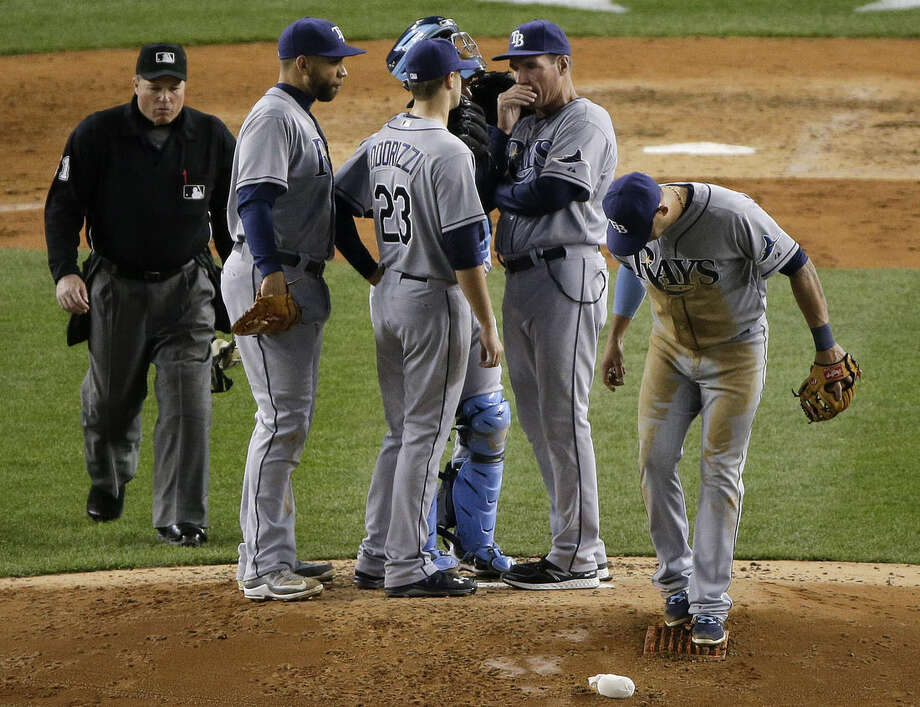 Tampa Bay Rays pitching coach Jim Hickey talks with pitcher Jake Odorizzi (23) in the fifth inning of a baseball game against the New York Yankees, Tuesday, April 28, 2015, in New York. (AP Photo/Julie Jacobson)