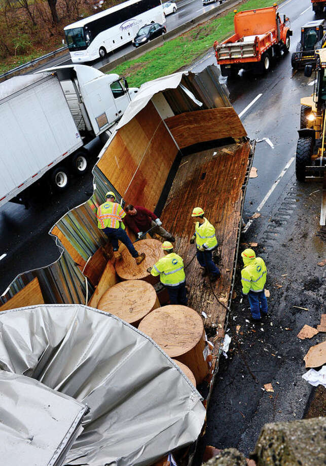 CT DOT help unload cargo from a tractor trailer that crashed into the Strawberry Hill Ave overpass Tuesday morning on I-95 Northbound at exit 16