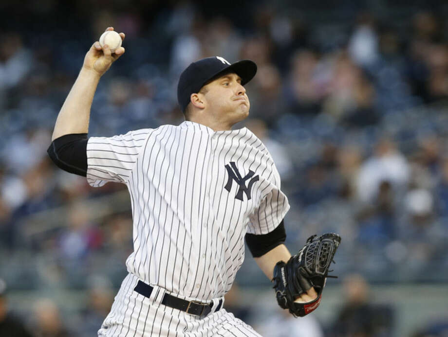 New York Yankees starting pitcher Chase Whitley delivers during the first inning of a baseball game against the Tampa Bay Rays at Yankee Stadium in New York, Tuesday, April 28, 2015. (AP Photo/Kathy Willens)