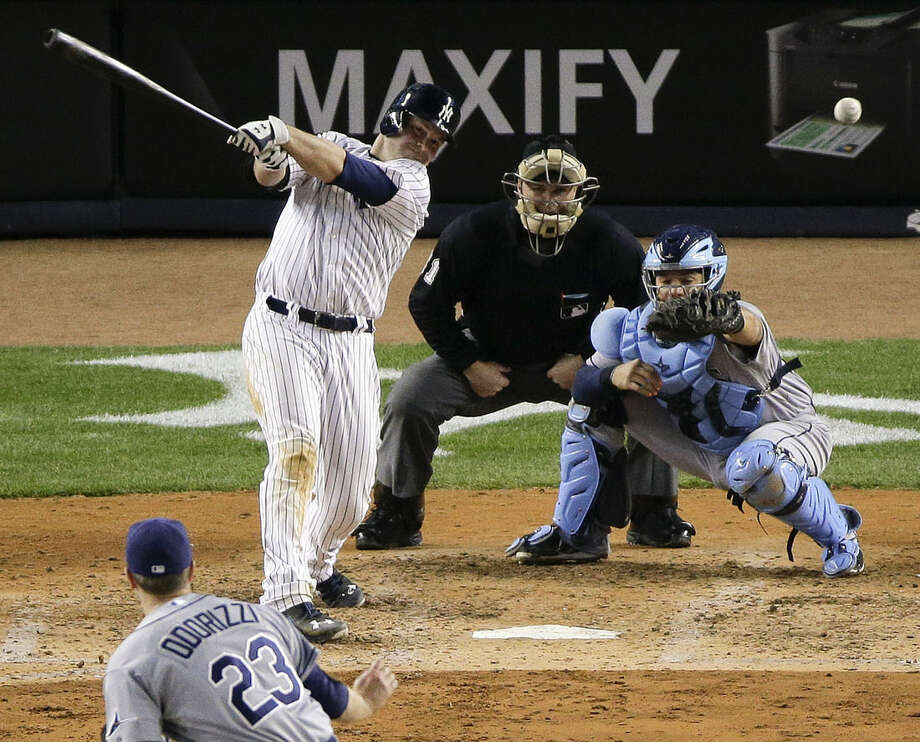 New York Yankees Brian McCann doubles to left field to drive in two runs against the Tampa Bay Rays in the fifth inning of a baseball game, Tuesday, April 28, 2015, in New York. (AP Photo/Julie Jacobson)