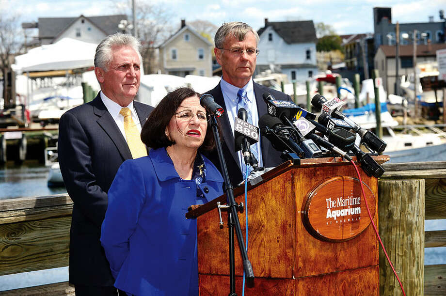 Hour photo / Erik Trautmann Local officials including Norwalk Mayor Harry Rilling, DOT Commissioner, James Redeker, and State Senator Toni Boucher, talk about the Walk Bridge during a press conference at the Maritime Aquarium Tuesday afternoon.