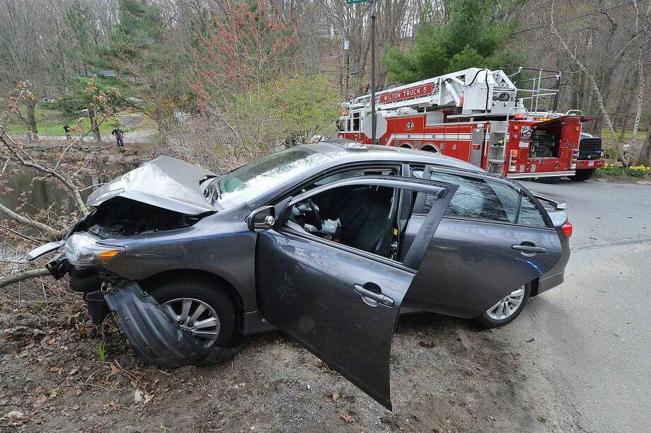 This Toyota sedan was involved in a two-car accident that sent a Honda CRV into Horseshoe Pond in Wilton Center on Monday afternoon. The drivers of both vehicles were transported to Norwalk Hospital.