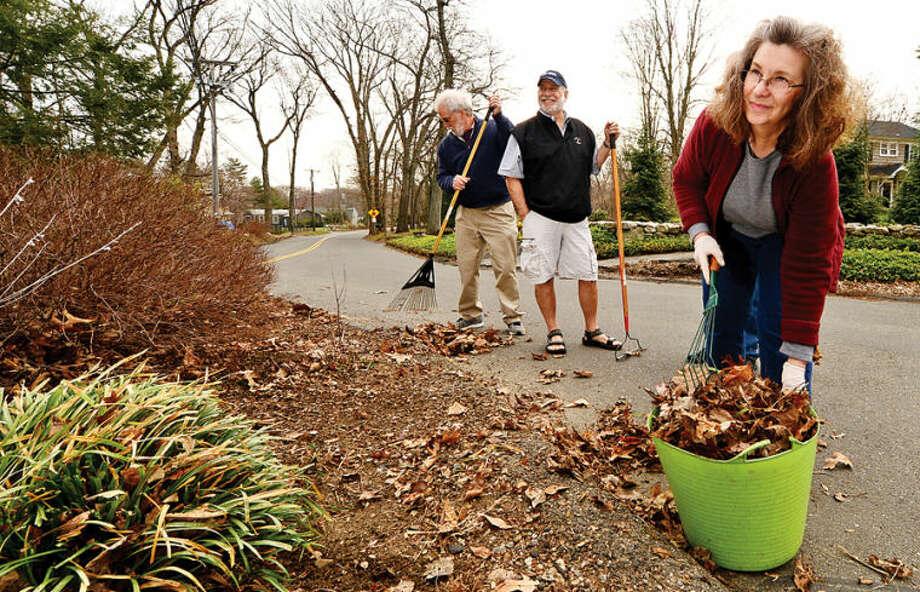 Hour photo / Erik Trautmann Steve Wallerstein, Adopt-a-Spot coordinator, and Rick Wetzel, left and Maggie Swanson, right, who volunteered to adoptthe Allen and East Rocks Rd. traffic island. National Volunteer Week April 6 through April Rick