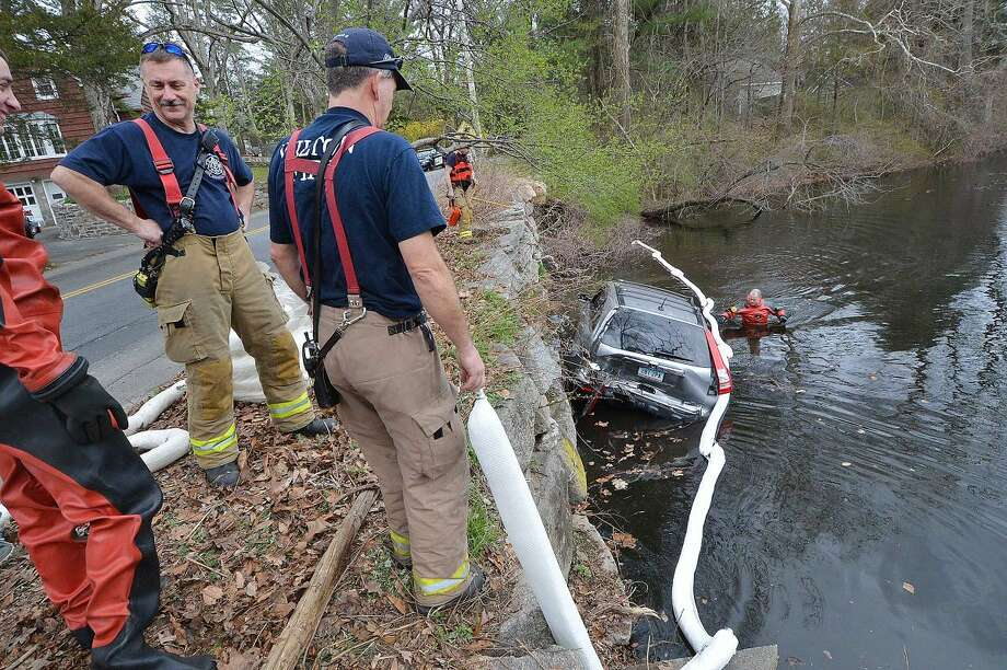 A two-car accident sent this Honda CRV over the wall into Horseshoe pond on Monday, the driver was already out of the vehicle when emergency personnel arrived. Horeshoe Road was closed in both directions for over an hour until the car was pulled from the water. The driver of the other car, a Toyota sedan, and the driver of the Honda were transported to Norwalk Hospital.