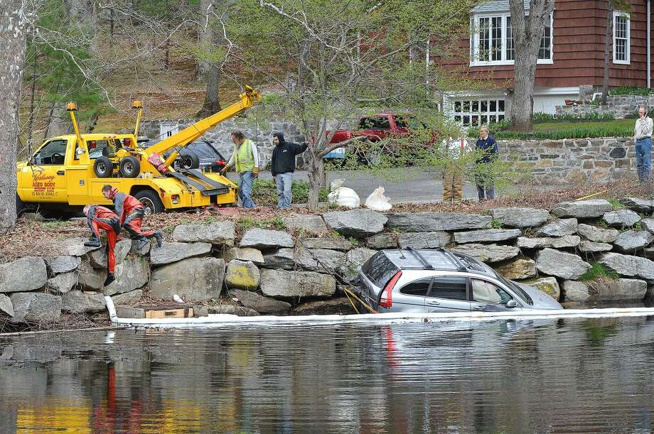 A two-car accident sent a Honda CRV into Horseshoe Pond in Wilton Center on Monday afternoon. The drivers of both vehicles were transported to Norwalk Hospital.