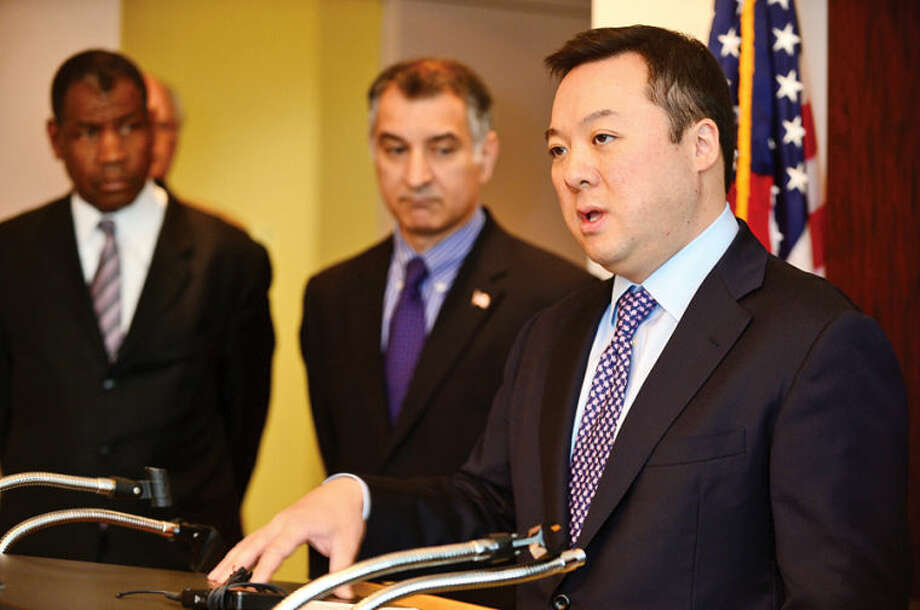 State Rep. William Tong, state Senator Carlo Leone and Mayor David Martin join the Connecticut Fair Housing Center, Homes Saved by Faith, and the Rev. Dr. Robert W. Perry of Union Baptist Church during a press conference Tuesday morning to announce free monthly classes for Fairfield County homeowners facing foreclosure.