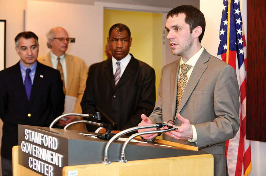 Jeffrey Gentes, managing attorney for the Connecticut Fair Housing Center, state Rep. William Tong, state Sen. Carlo Leone and Mayor David Martin join Homes Saved by Faith, and the Rev. Dr. Robert W. Perry of Union Baptist Church during a press conference Tuesday morning to announce free monthly classes for Fairfield County homeowners facing foreclosure.