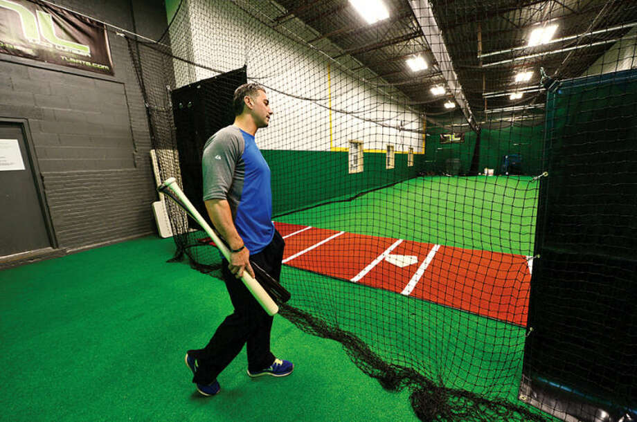 Hour photo / Erik Trautmann Pete Tucci tours the new faciilty for his baseball bat company, Tucci Lumber, which houses a batting cage on Wilson Ave.