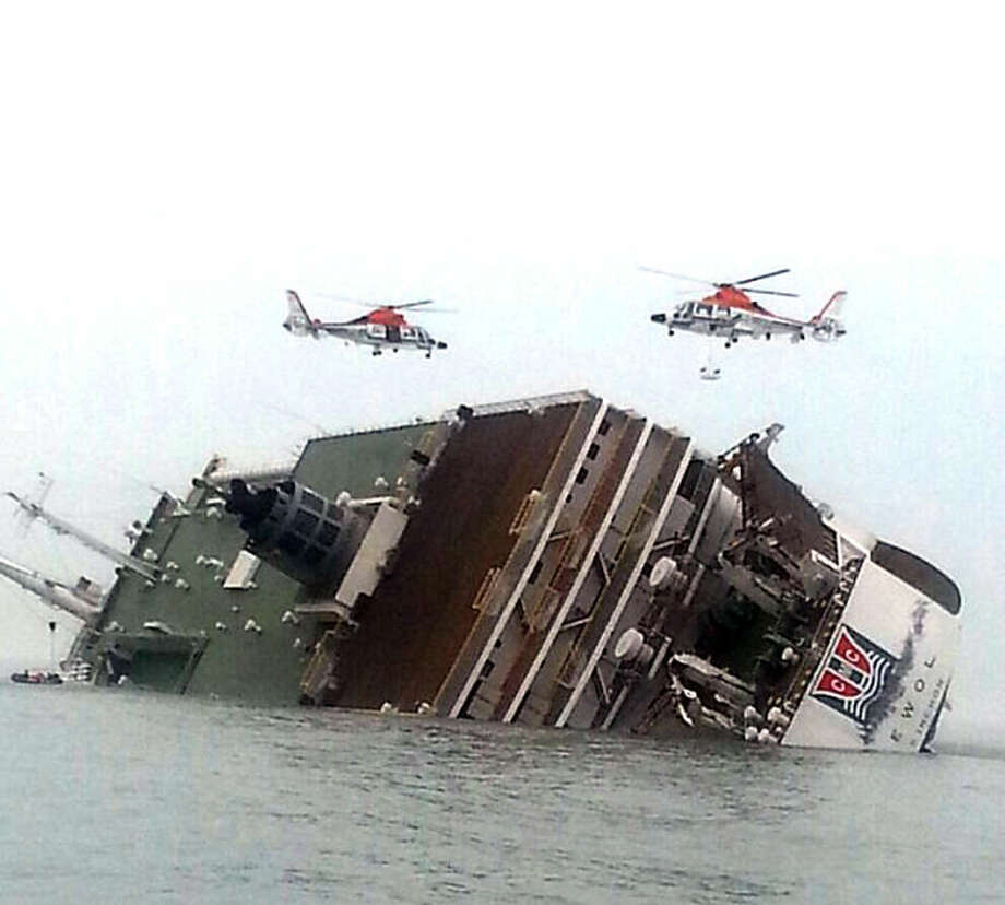 South Korean rescue helicopters fly over a South Korean passenger ship, trying to rescue passengers from the ship in water off the southern coast in South Korea, Wednesday, April 16, 2014. The South Korean passenger ship carrying more than 470 people, including many high school students, is sinking off the country's southern coast Wednesday after sending a distress call, officials said. There are no immediate reports of causalities. (AP Photo/Yonhap) KOREA OUT