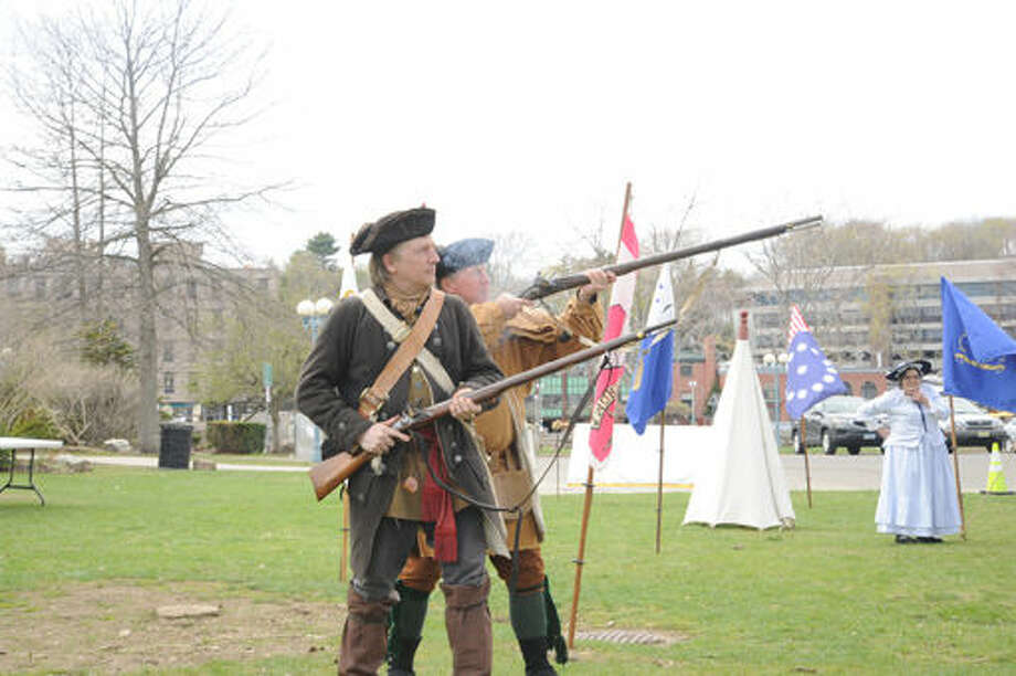 David Perkins and Todd Gerlander both members of the Connecticut Sons of the American Revolution fire muskets Sunday at Jesup Green in Wesport at the celebration of Minute Man Day. Hour photo/Matthew Vinci